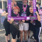 Team Gold members celebrate after completing Stafford 10K 2016